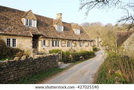 View of Old English Cottages on a Country Road - stock photo