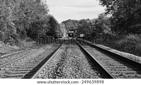 View of Old Railroad Tracks in Black and White - stock photo