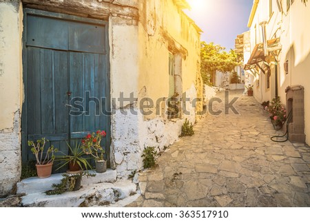 View of old town in Chania, Crete in greek in beautiful evening light at sunset with retro vintage. - stock photo