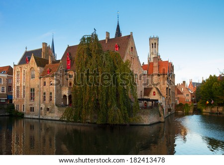 view of old town of Bruges with Belfort tower amd canals, Belgium