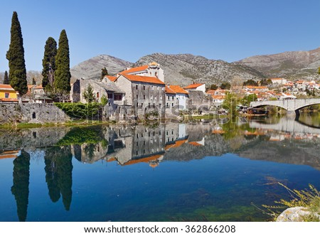 View of old town with reflection in river, Trebinje, Bosnia and Herzegovina. - stock photo