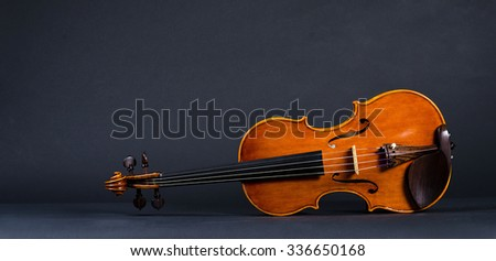 view of old wooden violin on black background - stock photo