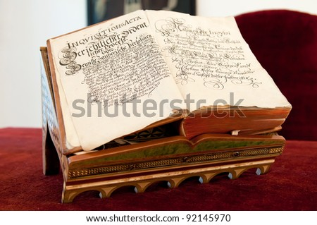 View of opened old book, written in Latin. - stock photo
