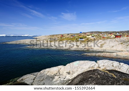 View of Oqaatsut Settlement (Rodebay) - Oqaatsut, formerly Rodebay, is a settlement in the Qaasuitsup municipality, in western Greenland. It had 46 inhabitants in 2010. - stock photo