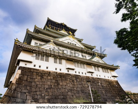 View of Osaka Castle in summer season with green garden, Japan