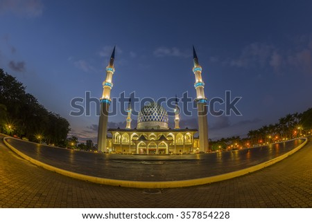 View of panoramic Sultan Salahuddin Abdul Aziz Shah mosque at dusk, Shah Alam Malaysia with fish eye view lens