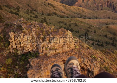 View of Paragliding backlit flying over mountain in Tenerife, Canaries - stock photo