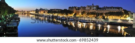 View of Paris Seine riverside in the morning from Concorde Bridge, d'Orsay museum - stock photo