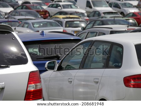 View of parked car in crowded parking lot - stock photo
