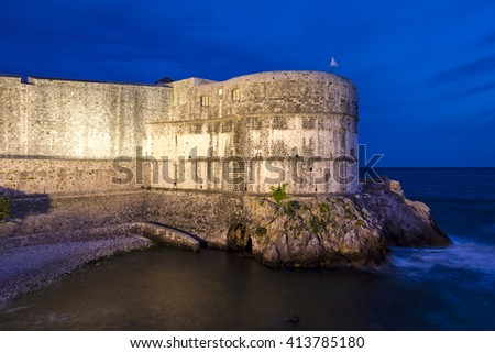 View of part of the city walls of Dubrovnik at twilight or dusk, Croatia. - stock photo