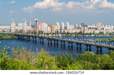View of Paton Bridge and Left Bank of the Dnieper river in Kyiv, Ukraine - stock photo