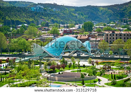 View of Peace Bridge on the River Kura and  European Park. Tbilisi, Georgia - stock photo