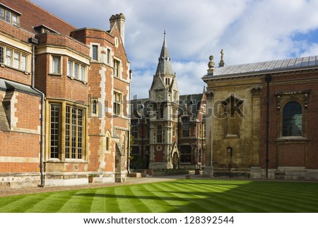 View of Pembroke College in Cambridge, United Kingdom in a bright sunny day with white clouds on the blue sky. - stock photo