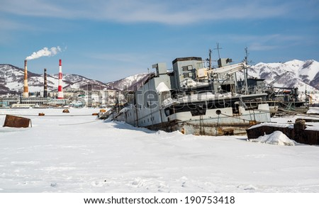 View of Petropavlovsk-Kamchatsky deserted vessels and power plant. Far East, Russia - stock photo