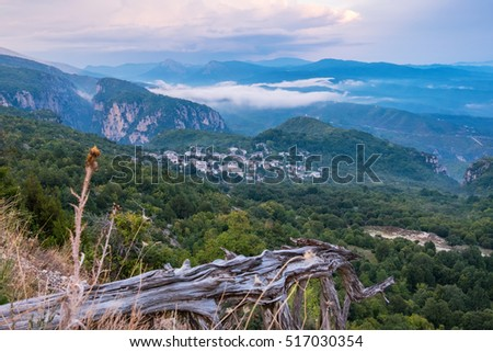 View of Pindus mountain range after sunset. Monodendri on a distance. Zagoria, Epirus, Greece