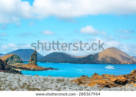 View of Pinnacle Rock and Sullivan Bay in the Galapagos Islands - stock photo