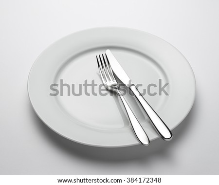 View of place setting with plate, knife and fork, with clipping path