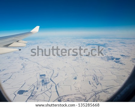 view of plane wing with the snow Russia - stock photo
