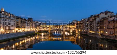 View of Ponte Vecchio at night. Panoramic version. - stock photo