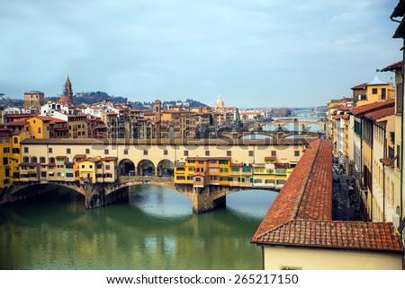 view of ponte vecchio over the river Arno  - stock photo