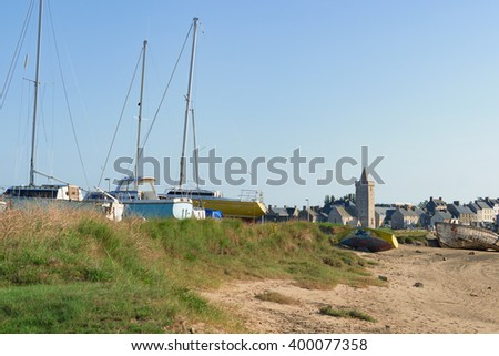 View of Portbail in France, Normandy in tidal with Boats - stock photo