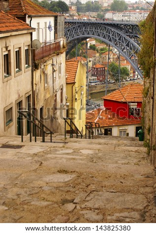 view of Porto in Portugal with the famous bridge over the river Douro from the famous architect Eiffel - stock photo