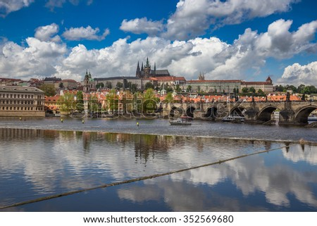View of Prague Across the Vltava River With Prague Castle, Charles Bridge and St. Nicholas Cathedral - stock photo