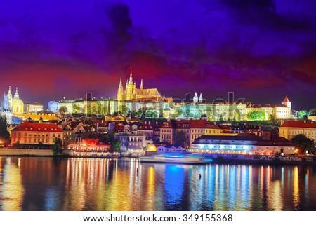 View of Prague Castle -famous historic bridge that crosses the Vltava river in Prague, Czech Republic.  - stock photo