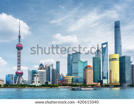 View of Pudong skyline (Lujiazui) in Shanghai, China. Skyscrapers of downtown on waterfront. The Shanghai Tower in city business center is visible at right, the Oriental Pearl Tower at left. - stock photo