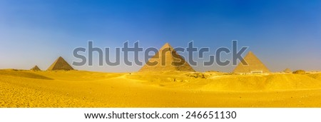 View of pyramids in Giza: Queens' Pyramids, the Pyramid of Menkaure, the Pyramid of Khafre and the Great Pyramid of Giza (Khufu or Cheops) - stock photo
