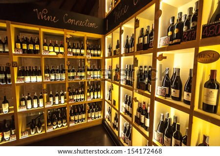 View of racks with wine bottles at wine cellar - stock photo