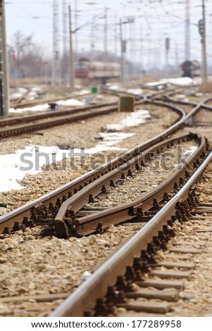 View of rail station selective focus on the tracks  - stock photo