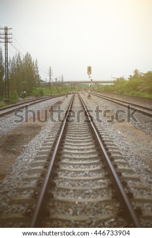view of railway with green tree at left and right side of railway,filtered image, light effect added, selective focus - stock photo