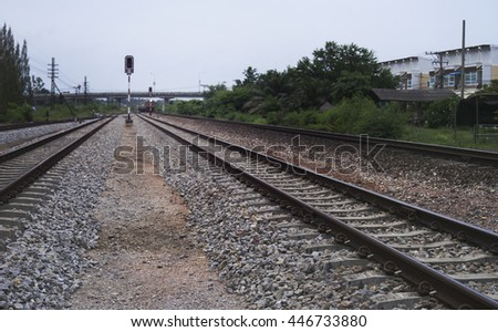 view of railway with green tree at the right side of railway, traffic of railway ,filtered image, selective focus - stock photo