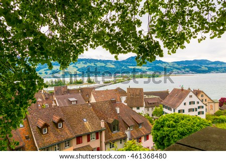 View of Rapperswil red tile roofs and Zurich lake. Rapperswil, Switzerland