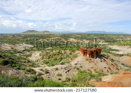 View of ravine Olduvai Gorge, one of the most important paleoanthropological sites in the world - the Cradle of Mankind. Great Rift Valley, Tanzania, Eastern Africa. - stock photo