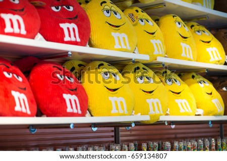 View of Red and Yellow MM pillows in the MM Store located in Times Square, NYC, NY on June 18, 2016