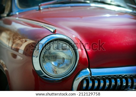 View of red classic vintage Soviet car Gaz  - stock photo