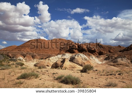 View of red rock formations in Goblin Valley with blue sky?s the and clouds
