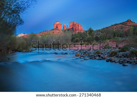 View of red rocks and river at the famous Castle Rock in Sedona, Arizona, AZ, an American landmark - stock photo