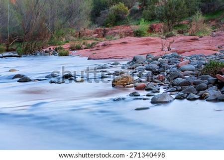 View of red rocks and river at the foot hills of the famous Castle Rock in Sedona, Arizona, AZ, an American landmark - stock photo