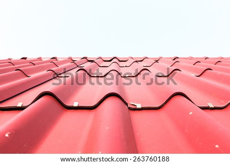 View of red roof tiles and white background. - stock photo