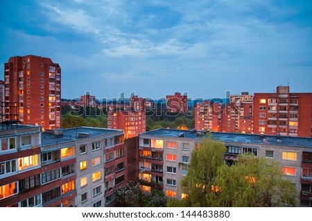 view of residential houses with lit windows at night, Vilnius, Lithuania
