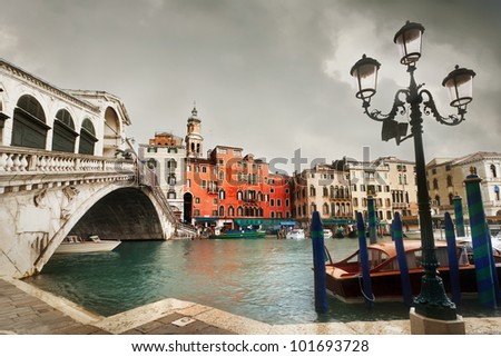 View of Rialto bridge and Grand Canal in Venice. - stock photo