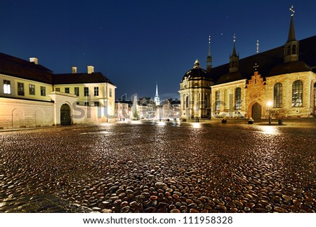 View of Riddarholmen church and the Old Town at night, Stockholm, Sweden. - stock photo