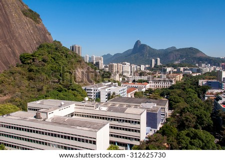 View of Rio de Janeiro while Going Down by Cable Car from Urca Mountain - stock photo