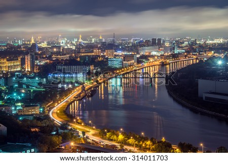View of river in the city at night time.
