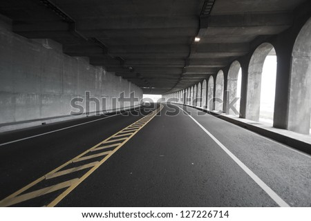view of road tunnel along seaside,Taiwan