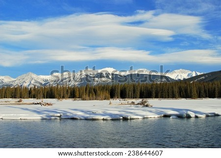 View of Roche Bonhomme from the Frozen Athabasca Riverbank, Jasper National Park, Alberta, Canada, UNESCO World Heritage