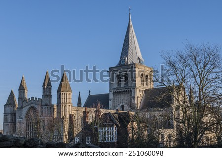 View of Rochester Cathedral in Kent which is the second oldest cathedral in England, founded 604 AD. The cathedral attracts thousands of visitors and pilgrims each year. - stock photo